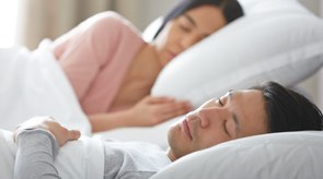 Couple sleeping peacefully on their mattress powered by the Lineal Adjustable Base