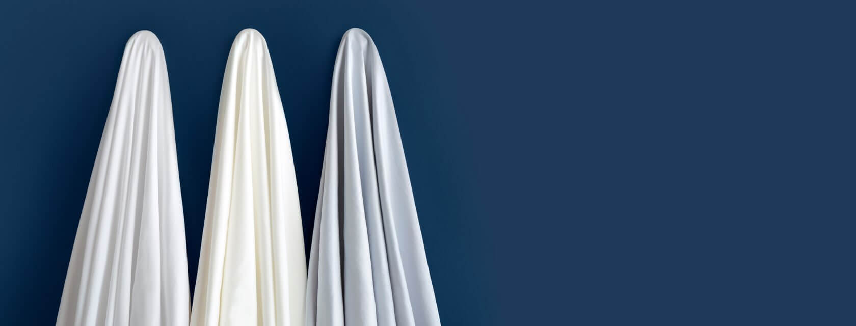 All three colors of Saatva sheets.